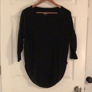Black Express sweater.